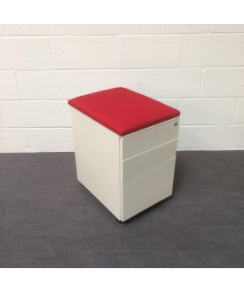 White mobile pedestal- red cushioned top