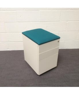 White mobile pedestal- turquiose cushioned top