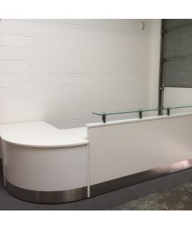 White reception suite with glass top