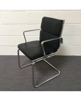 Black static meeting chair with chrome frame
