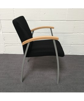 Black static chair with chrome frame and wooden arms